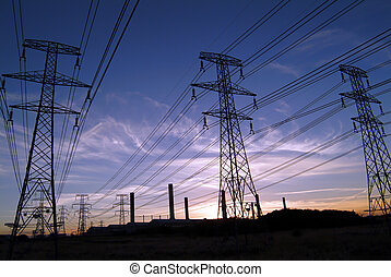 Power pylons - Three high voltage electricity pylons (towers...