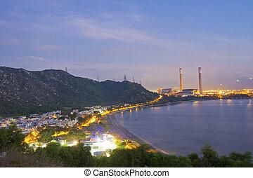 Power station along the seashore at night