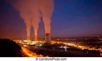 Power Station At Night Timelapse - Time lapse sequence of a...