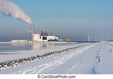 Power station in Dutch winter landscape