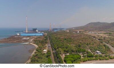 Power Station java, indonesia - power station by sea with...