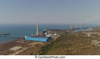 Power Station java, indonesia - power station by sea with ...