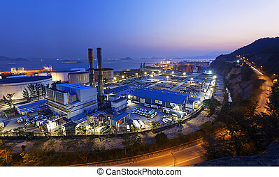 power station night - petrochemical industrial plant at...