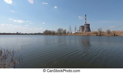 Power station on the lake. Pipes of a power station on the...