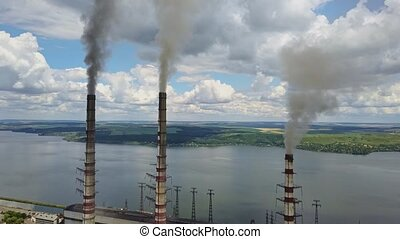 Power station with steaming chimneys - Power-plant with the...