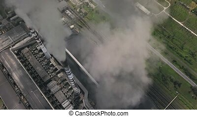 Power station with steaming chimneys - View from above at...