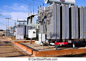 """Power substation with red """"Alive"""" warning sign"""