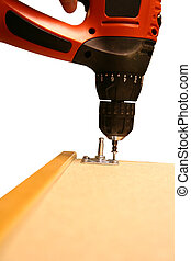 Power Tool Drilling Down a Screw on White Background