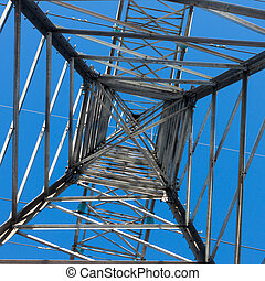 a long line of electrical transmission towers carrying high voltage lines