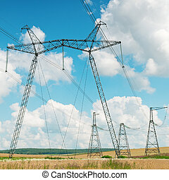 Power transmission line on a background of the cloudy sky