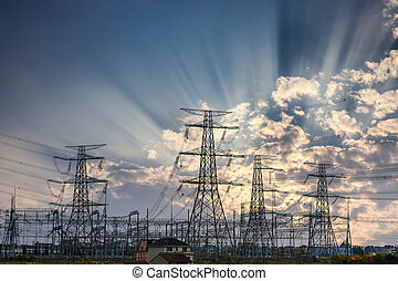power transmission tower and sun rays