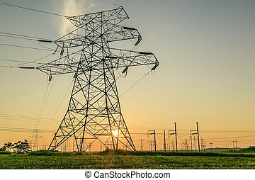 Transmission towers support the high-voltage conductors of overhead power lines, from the generating station up to the source substations located near populated areas.