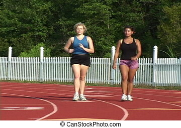 Power Walking - Two college coeds power walk around the...