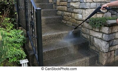 Power washing on outdoor concrete staircase in front yard garden spring 1080p hd