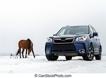 Powerful 4x4 offroader car and horse, winter landscape background