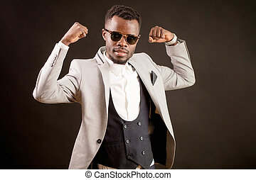 powerful African businessman shows biceps. Successful business. strong CEO.