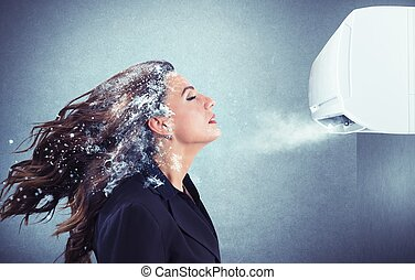 Powerful air conditioner - Frozen girl under a powerful air...