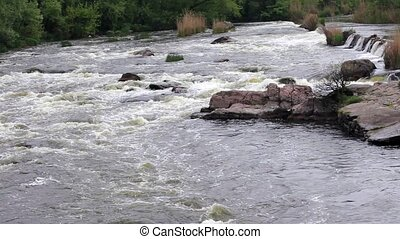 Powerful and rapid mountain river