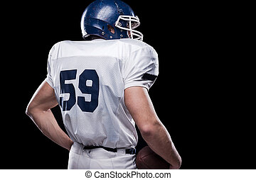 Powerful back.  Rear view of American football player holding fo