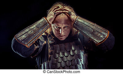 Powerful blond knight on the dark background