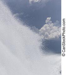 powerful boat creating huge wave