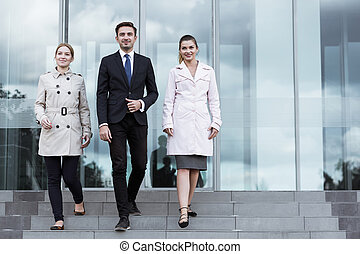 Powerful business team going for important meeting
