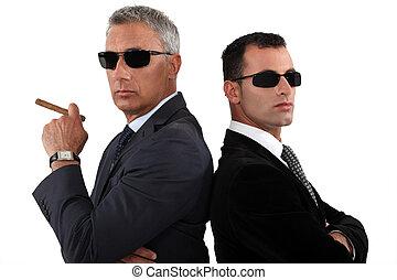 Powerful businessmen in sunglasses