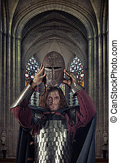 Powerful crusader is going to cover his head with a helmet....