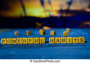 Powerful habits on wooden blocks.