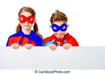 powerful kids - Boy and girl teenagers in a costume of...