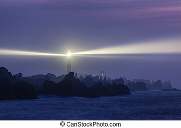 Powerful lighthouse at night