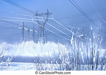 Powerful line of electricity costing in an environment of snowdrifts on a background of the blue sky
