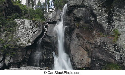 Powerful mountain cascade waterfall in the forest - Powerful...