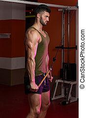Powerful Muscular Man Exercising Triceps