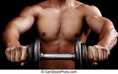 Powerful muscular man holding workout weight