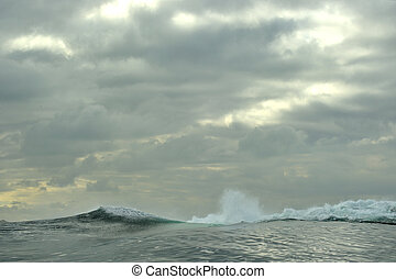Powerful ocean waves breaking. Wave on the surface of the...