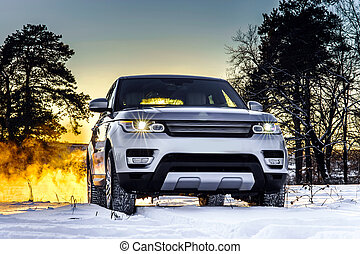 Powerful offroader car view on winter landscape background