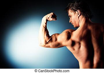 powerful - Portrait of a handsome muscular bodybuilder...