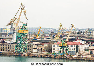 Powerful shipbuilding shipyard with a pier and cranes