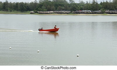 Powerful speed boat with guards driving the lake, stock...
