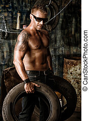 powerful - Handsome muscular man in the old garage.