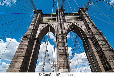 Powerful structure of Brooklyn Bridge Center Pylon on a beautiful summer day.