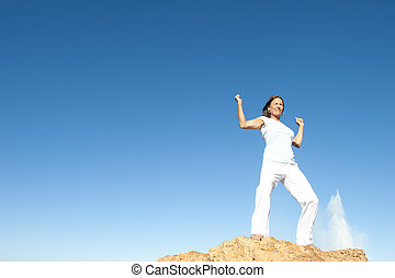 Powerful, successful confident woman sky background