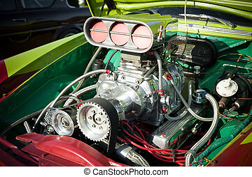 powerful supercharge blower inside a colorful hot-rod engine bay