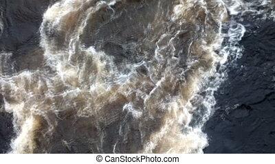 Powerful swirl of falling water from dam 2