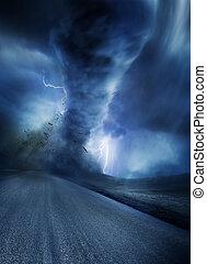 Powerful Twister - Powerful Tornado with debris on a road....