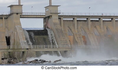 Powerful water discharge through gate of power plant