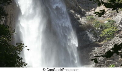 Powerful water flow in the Uchan-su falls on the mountain of...