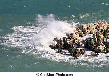 Powerful waves crashing on a rocky beach