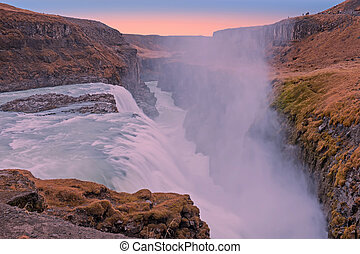Powerfull Gullfoss Waterfalls in Iceland at sunset